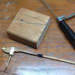 This jig helps cut a hammer shank.